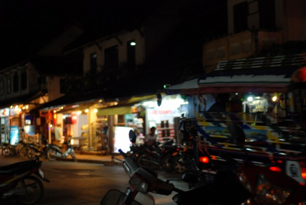 A tuk tuk parked in the street in Luang Prabang
