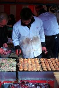 Cooking takoyaki at Kobosan