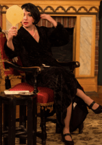 Alla checking her image in her dressing room before appearing as Madame Ravenskaya in The Cherry Orchard