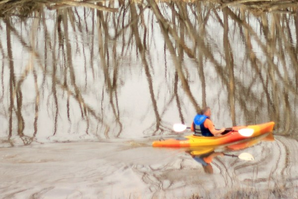 Tight crop of the kayaker on the river