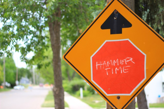 "Stop sign with ""Hammer Time"" written on it in chalk"