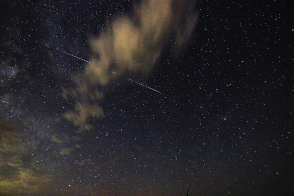 The International Space Station ducks behind a cloud
