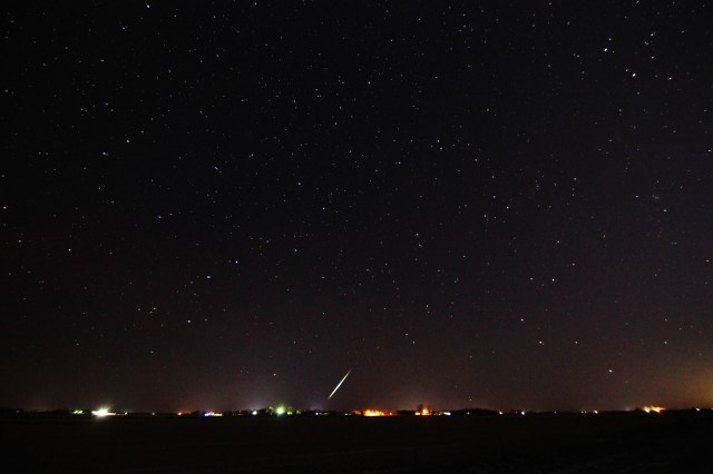 A meteor streaks over the horizon