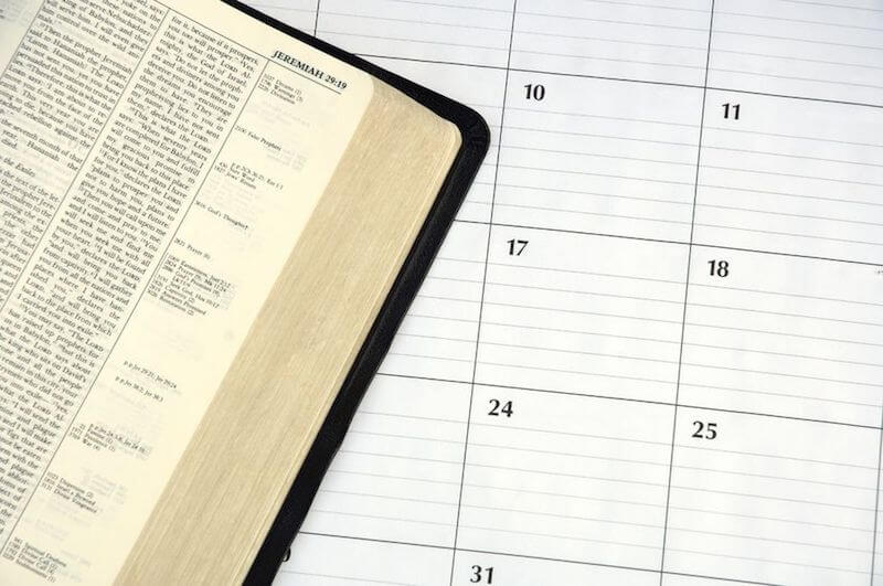 Daily devotions showing Bible and a calendar