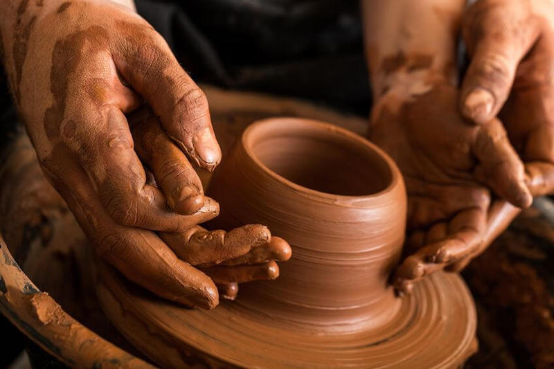 Fearfully made by God image showing a porter molding a clay jar