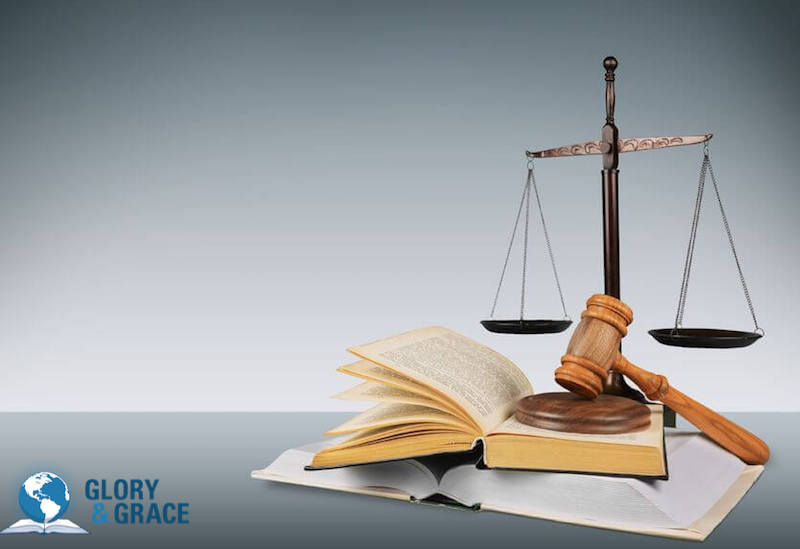 What is the law? Image showing a pair of balances on a book