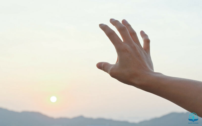 The touch of God showing a hand