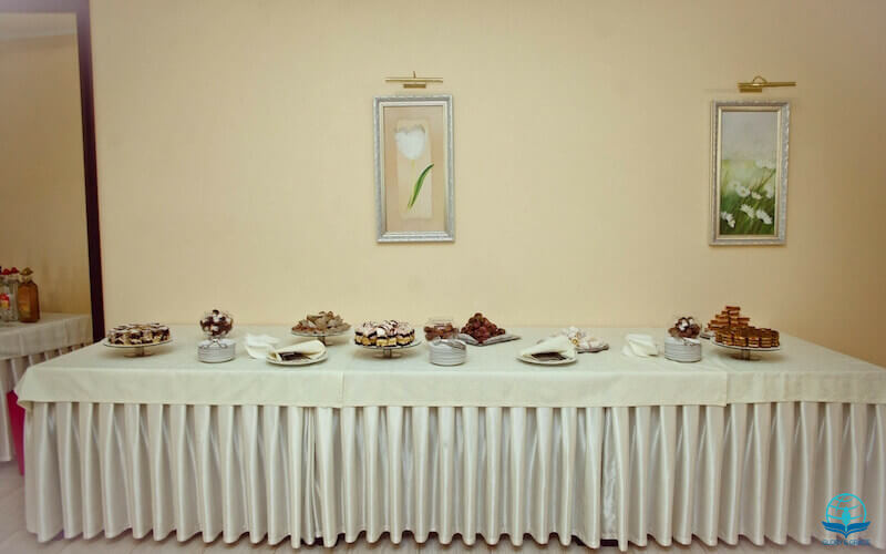 Abundantly satisfied with fatness in God's house image showing a buffet table