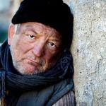 Poor in spirit showing a poor homeless man