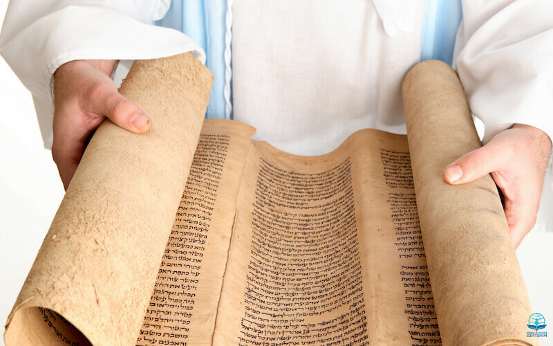 Who is a minister? Image showing a man holding a scroll