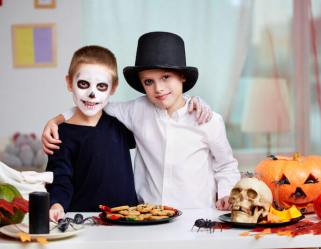 spirit of antichrist showing two kids celebrating halloween