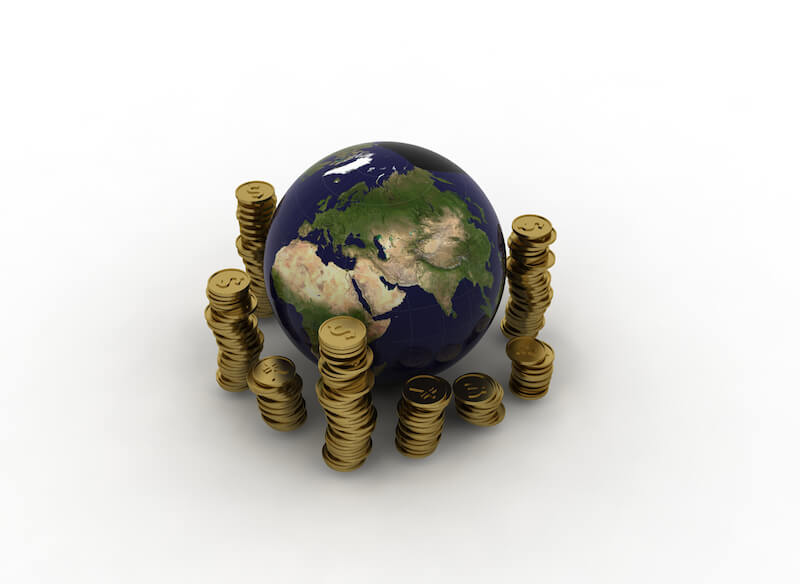 Spiritual riches showing coins around the earth