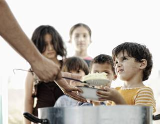 distributing to the necessity of saints showing hungry children in a camp