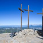 Your theology showing three crosses on a mountain