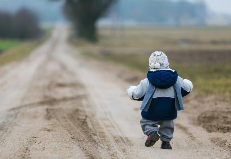 Walking in love showing a little boy walking