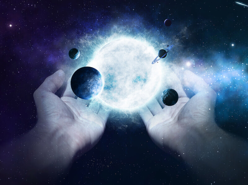 Manifestations of God showing two hands holding the earth