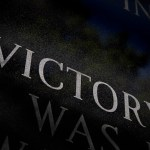 victory showing the letters of the word in a dark background