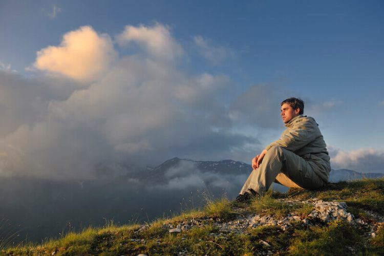 shew me thy glory showing a man sitting and looking up to heaven