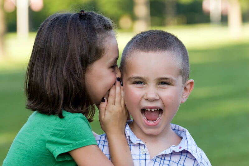 slander of grace showing a girl whispering to her brother