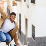 A merry heart maketh a cheerful countenance showing a young man jumping up in joy