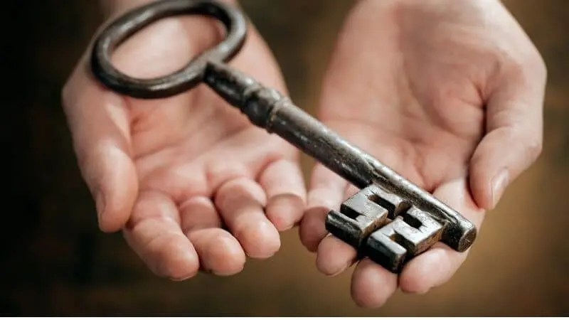Unto You it is Given to Know the Mystery of the Kingdom of God showing a key in a person's hands
