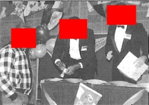 "These well-dressed greeters actually were part of a federal undercover operation dubbed ""No Such Thing as a Free Lunch."" Source: U.S. Marshals Service. Red blocks by PP Blog."