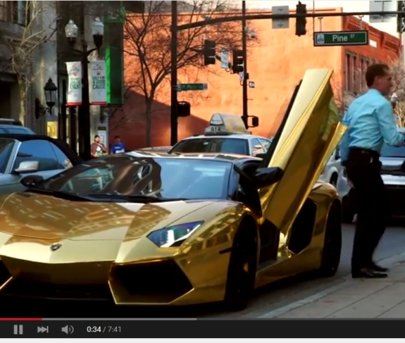 Daniel Fernandes Rojo Filho exits a gold Lamborghini in the area of Pine Street in Orlando, Fla. Source: DFRF promo on YouTube, c. April 2015.