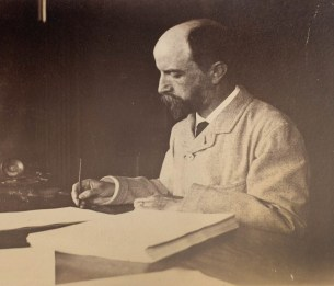 Henry_Adams_seated_at_desk_in_study,_writing,_in_light_coat,_photograph_by_Marian_Hooper_Adams,_1883 - A.jpg