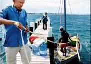 Geert van der Kolk and crew members Jean Oblit Laguerre and Gracien Alexandre tie up the Sipriz near Miami Photo: courtesy of Trenton Daniel