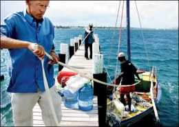 Geert van der Kolk and crew members Jean Oblit Laguerre and Gracien Alexandre tie up the Sipriz near Miami Photo: courtesy of Trenton Daniel