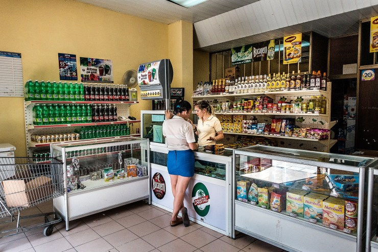 Workers in a CUC shop managed by the government in Sancti Spiritus.