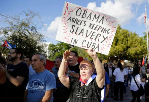 Protesters in the Little Havana neighborhood of Miami hold a demonstration in December 2014 against President Barack Obama's plan to normalize relations with Cuba. (Photo: Lynne Sladky/AP)