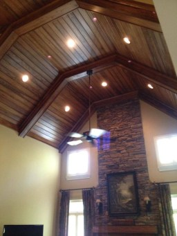 We installed the can lights and ceiling fan in this very tall ceiling!