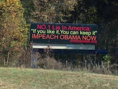 Overpass protestors take anti-Obama message to billboards