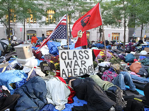 Occupiers fly desecrated American flag with Marxist and anarchist flags