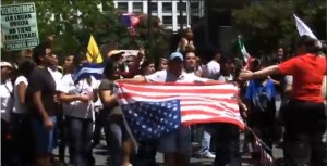 Anti-Americans invert flag  at pro-illegal immigration rally