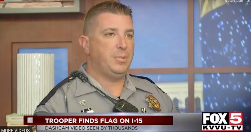 Nevada Trooper Saving Flag on Highway