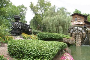 Klondike Katie steam engine creeps past the Grist Mill at Dollywood