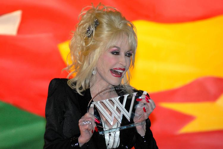 Dolly Parton receiving the Woodrow Wilson Award in 2008