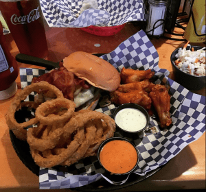 Burger and onion rings with chicken wings at Blue Moose