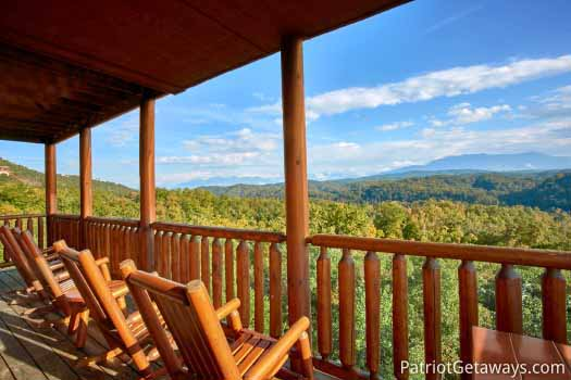 Rocking chairs on a covered porch of a cabin called The Big View in Pigeon Forge, TN