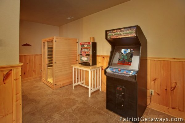 Arcade game and sauna in Taj Mahal's game room. A Pigeon Forge cabin rental.