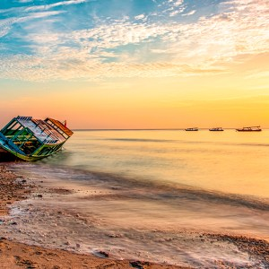 Photograph by professional Patrizia Acco Photographer, Beach, Colours, Summer, Landscape, Beachscape, Seascape, Water, Sunset, Sunrise, Oceans, Sand, Harbour, Patience, Peaceful, Stunning, Tranquil, Beautiful, Colourful, Photography, Landscape photographer, Nature, Boats, Boats Harbour, professional Patrizia Acco Photographer, wreck, shipwreck, boat, sky, sea, blue, abandoned, ocean, travel, bay, coast, corrosion, old, water, tourism, landscape, sunset, rusty, stranded, transportation, coastline, vessel, seashore, disaster, wooden, adventure, tropical, sun, nature, shore, broken, rust, history, beach, beached, fishing, island, storm, rock, crash, decay, holiday, clouds, underwater, depth, outdoors, submerged, sinking, waves, sandy, wood, shipwrecked, scenery, accident, beautiful, structure, transport, tourist, bottomless, vessels, daytime, colorful, sunlight, under, landmark, depths, aquatic, discovery, panoramic, shoreline, sunrise, destroy, seascape, seaside, dramatic, sunken, destroyed, horizon, shipbreaking, shipyard, corroded, outdoor, swimming, turquoise, summer, decadence, grounded, scrap, rotted, damaged, evening, wet, hole, seaweed, rusted, junk, corrode, grunge, break, sink aftermath, hurricane, capsize, flooded, overturned, sunk, dawn, red, cloud, wave, morning, surf, sunny, dream, sundown, getaway, silhouette, vacation, scenics, reflection, dusk, color, bright, majestic, tranquil, scenic, orange, golden, boats, Gili Trawangan,Bali, Indonesia