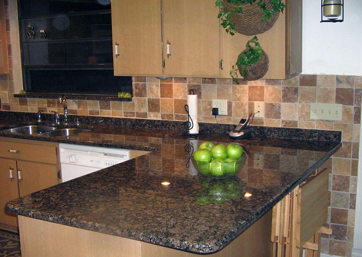 Baltic Brown Granite on Black Granite Countertops With Brown Cabinets  id=95462