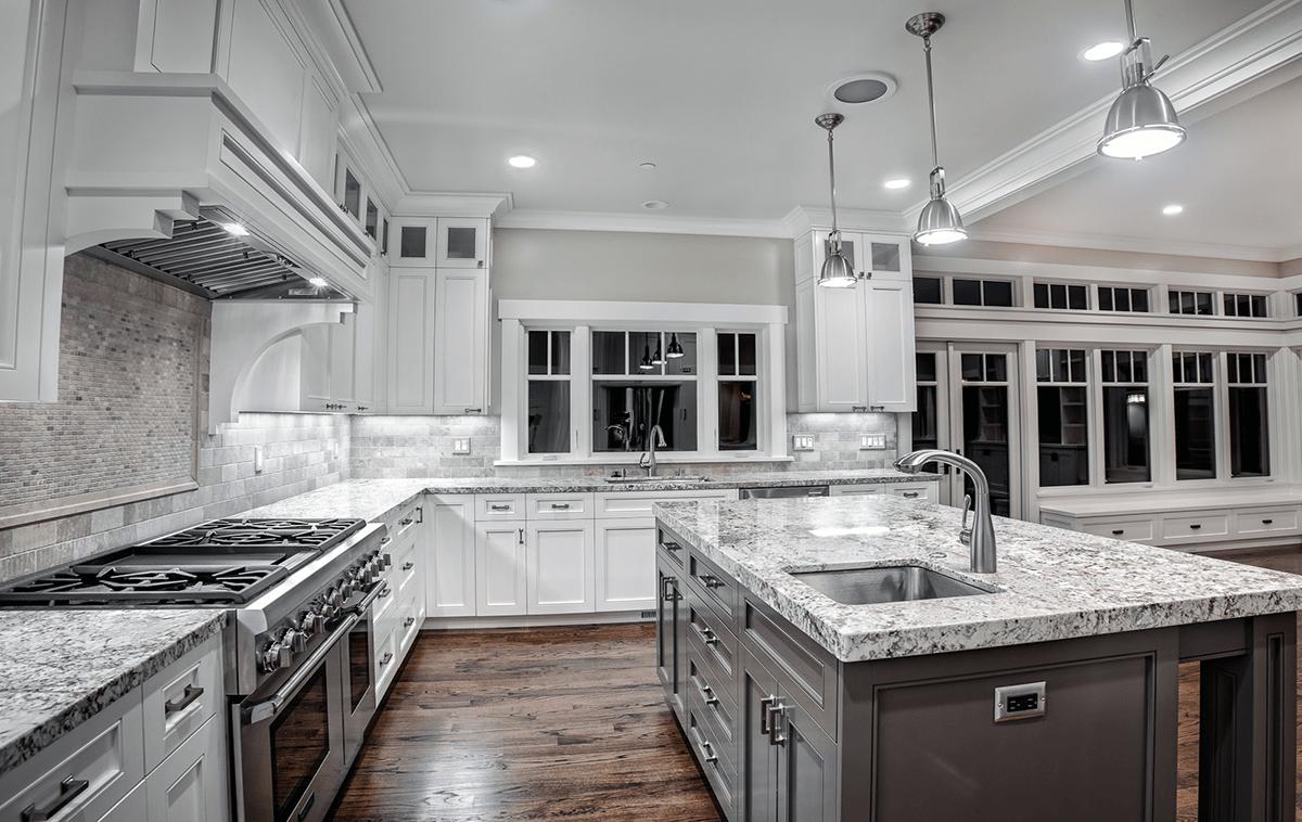 Alaska White Granite on Backsplash For Black Granite Countertops And White Cabinets  id=88573