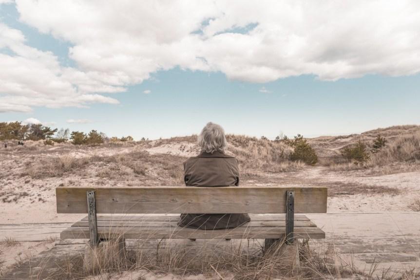 man on bench in desert