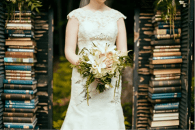 Fresh Garden Feel: One trend is a fresh garden picked look with traditional flowers. The shape that is used to achieve this look is called the crescent cascade; where your main focal flowers are in the middle and on the sides are the longer cascading vines. This combination gives the appearance that the flowers are overflowing from the bride's hands.