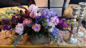 Unique Vessels: Out with the mason jars; in with the new! Couples are using different vessels for their centerpieces. Wood boxes, footed vessels or metal containers are some of the various options. Overflowing with big beautiful blooms these containers add a whole other element and charm to the centerpiece!