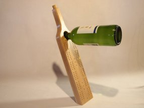 Hand carving and designing wine balancing carving boards or cribbage boards. Designs include Sea Driftwood from NH and Maine coastlines, solid hand carved wood, or vintage refurbished clocks.