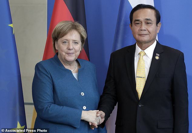 Merkel encourages Thai PM to lead his country to democracy